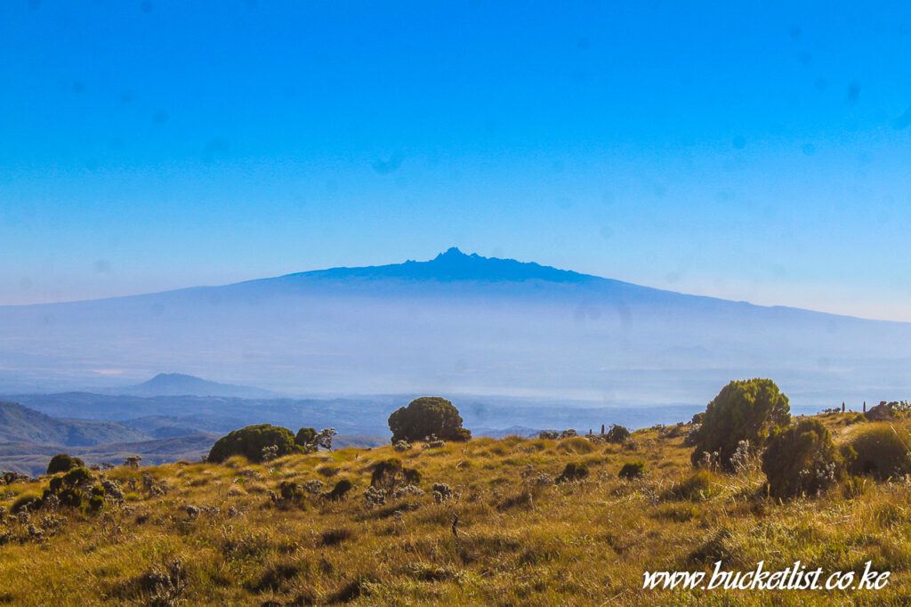 Mt Kenya rising above the skies as seen from Kinangop Peak